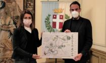 Deborah Compagnoni consegna la mappa dei luoghi turistici al sindaco Mario Conte